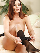 Fast bodied MILF slips off the lady nylons and plays along with her sensuous feet