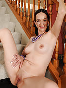 Gorgeous very long haired brunette Beth M spreads this girl legs spacious on the stairs
