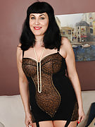 New adult model Claudine dips the strand of pearls inside this girl mature box