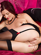 38 spring past times Sofia playfully stuffs her hands and fingers at her mature pussy