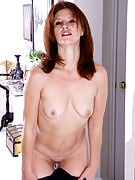 Redheaded MILF as part of sexy lingerie slips it odd and also spread shaved crotch