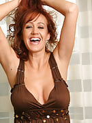 Hot MILF Bailey strips and takes on alongside her huge mams