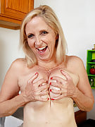 54 year older golden-haired housewife doing it simply right within the kitchen area