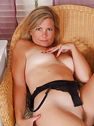 38 yr old MILF spreads her long thighs and also opens the lady pussy