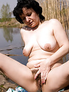 Sandra tugs at just her full bush while loving the scenes at just the waterfront