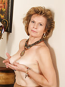 54 year older Judy strips out of her nylons and spreads this girl thighs