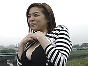 Aki Tomosaki Asian chick poses outdoors showing her big tits and nice ass