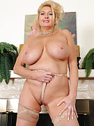 Busty and elegant 47 yr old Tahnee Taylor pising of the fireplace