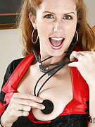 Mature redhead plays nurse and provides her older vagina a checkup