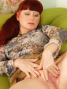 Redheaded Esmeralda splits this girl crotch together with her blank thong
