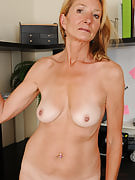 Slim 56 yr old Pam takes a break after her office work in order to spread out