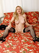 50 yr old MILF looking sexy as part of and out of her lingerie