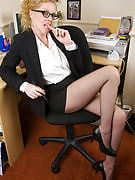 Blonde Taya performances away this girl huge breasts as part of these kinds of workplace pictures