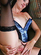 37 12 months old MILF as part of hot lingerie strips and additionally spreads her ass and also pussy