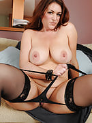 Busty Kitty t slips away her sensuous lingerie to pose her hot mature anatomy