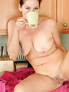 39 spring old housewife Xena spreads while experiencing her coffee in here