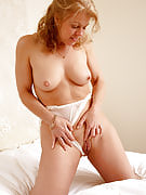 Lacey female Lauren E from 30 plus Ladies spreads the lady sensuous very long thighs
