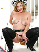 Horny golden-haired cowgirl as part of chaps spreads this girl long and adult thighs