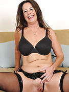 Lacy brunette MILF Tia licks her nipples and spreads her adult box