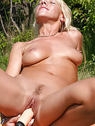 Mature Sylvie outside playing using the the lady lifelike rubber toy